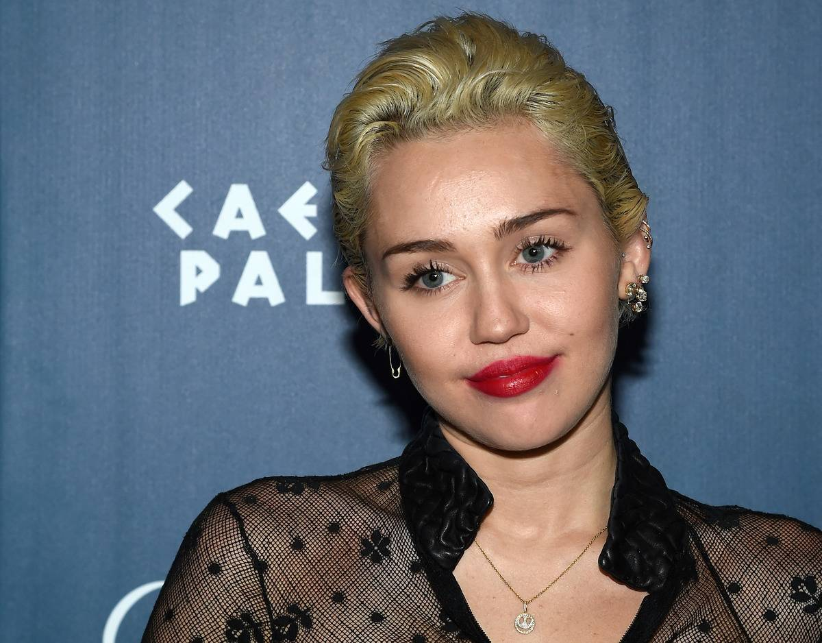 Miley Cyrus has pimples showing through her makeup at the Omnia Nightclub.