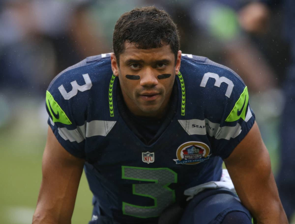 Quarterback Russell Wilson gets in position prior to the start of a game.