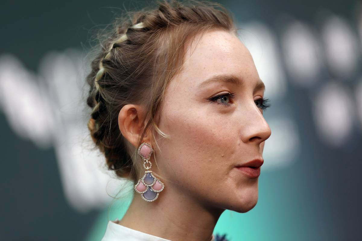 A close-up shows Saoirse Ronan's face at the Love Gala & European Premiere of