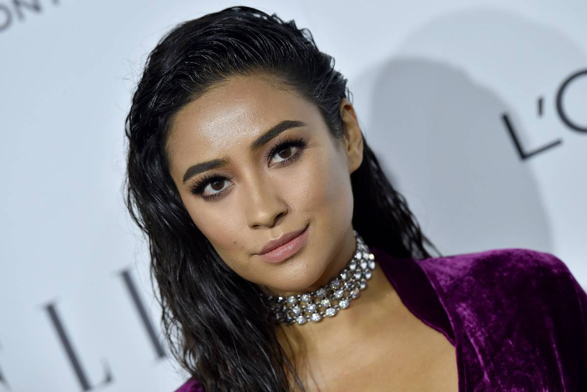 A close-up shot shows actress Shay Mitchell at the 23rd Annual ELLE Women In Hollywood Awards.