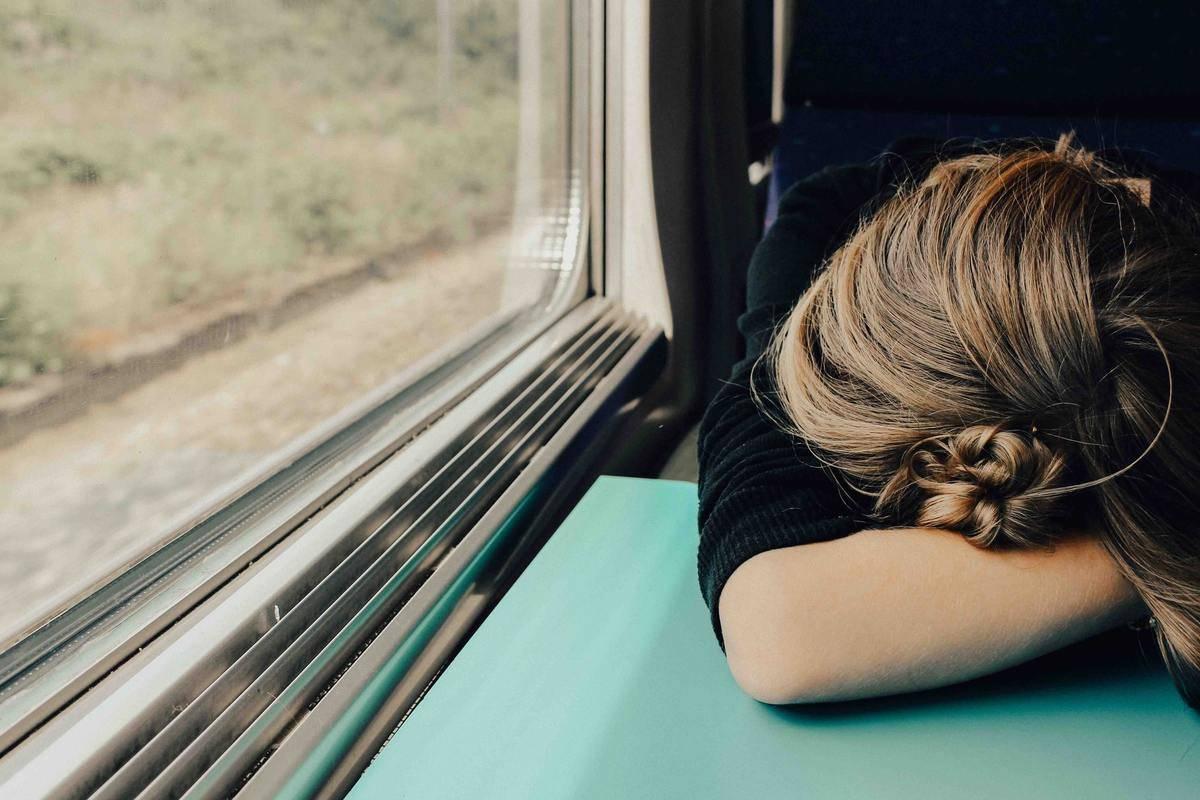 A woman fell asleep on the train.