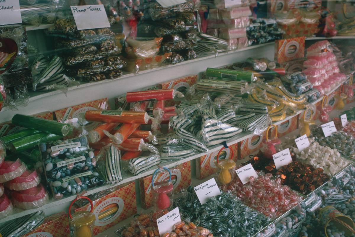 Various sweets and candies are arranged at a store.
