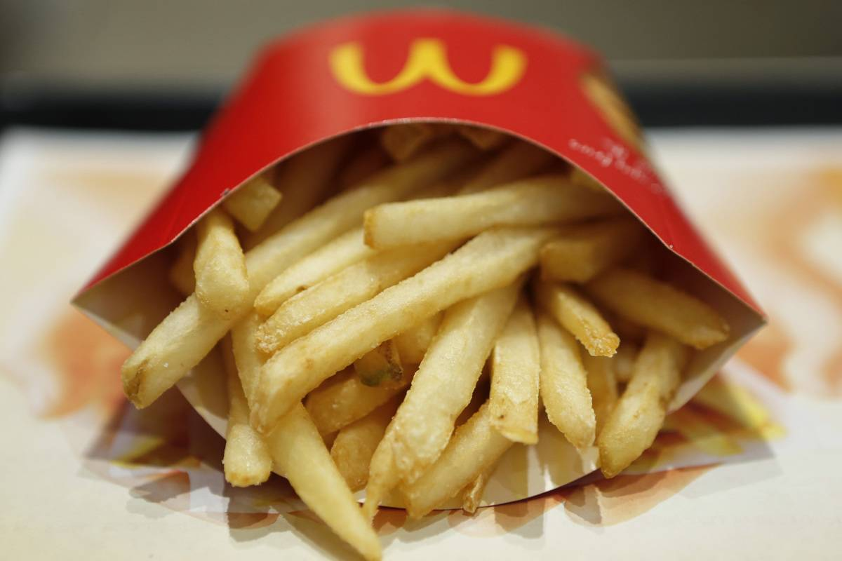 A container of McDonald's French fries is tipped over.