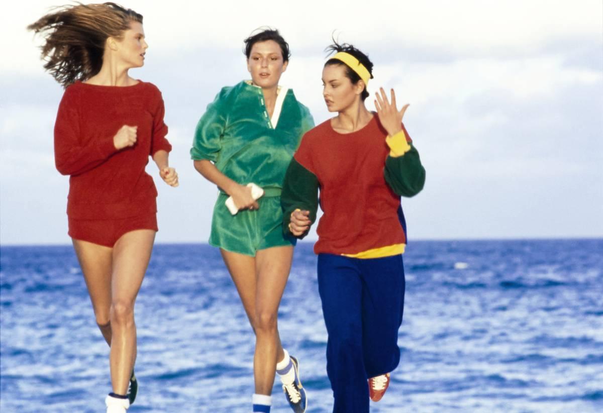 Models run on the beach.