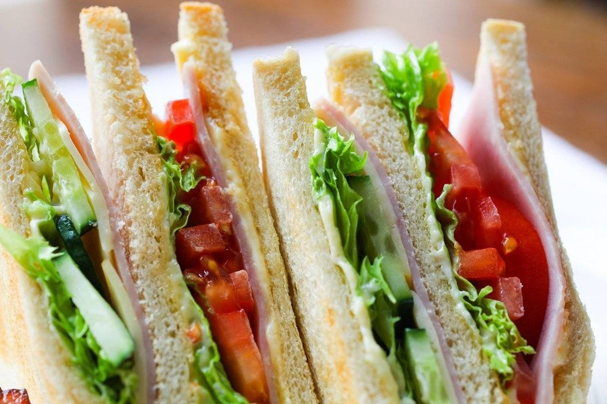 A close-up shows the sides of club sandwiches.
