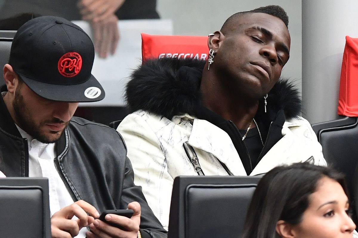 A man takes a nap while waiting at an airport.