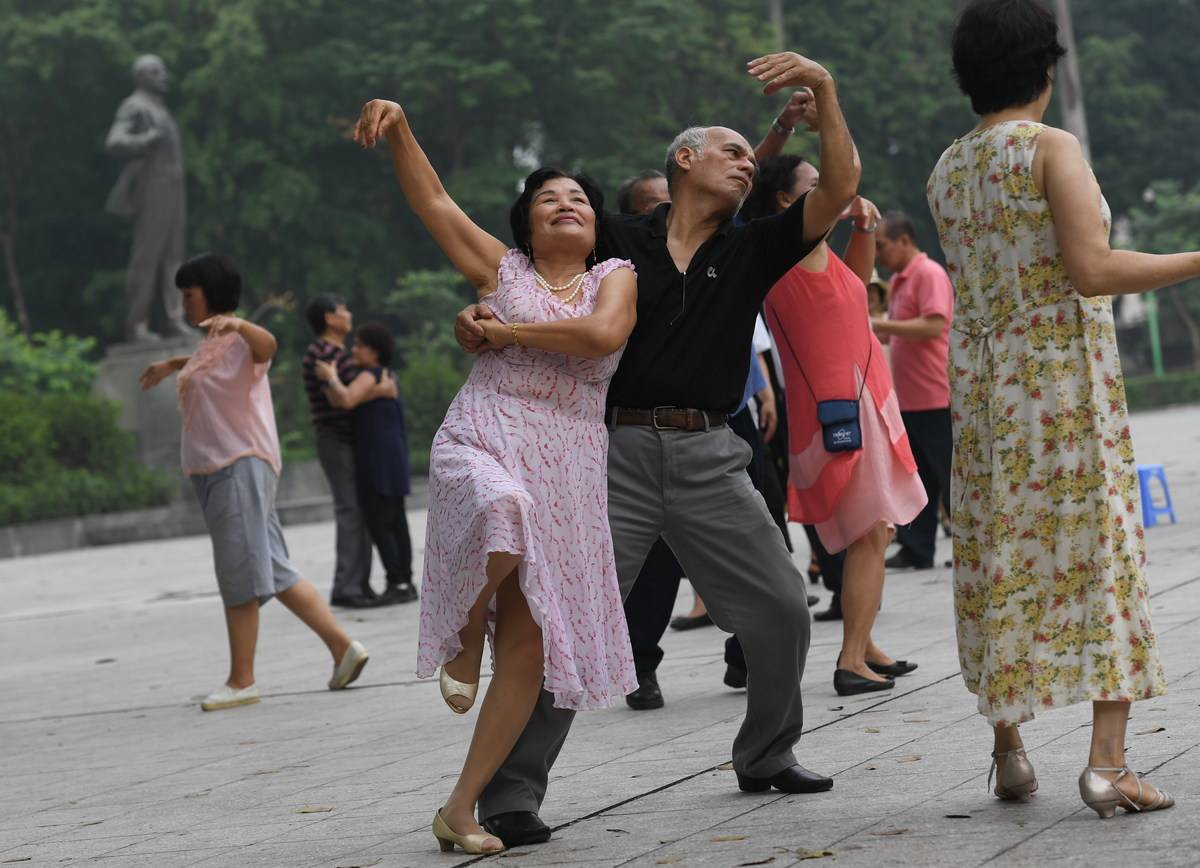 Older adults dance together as part of a dance club.