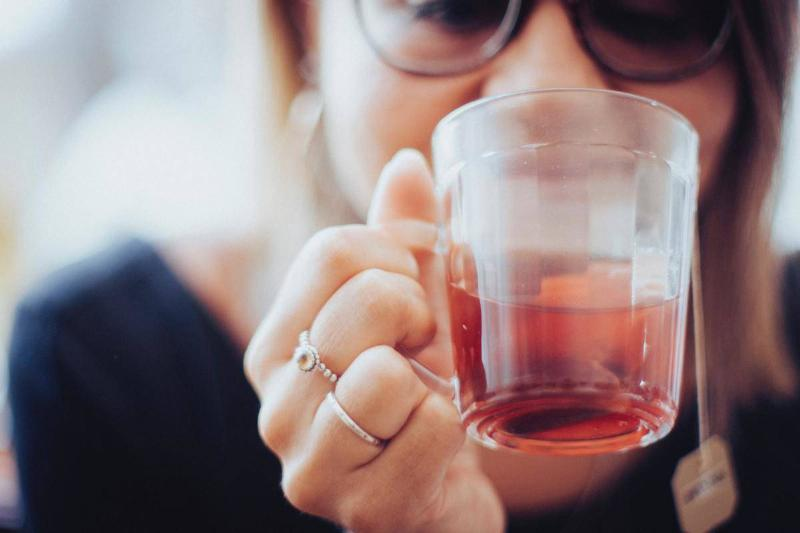 a woman drinking tea to relax