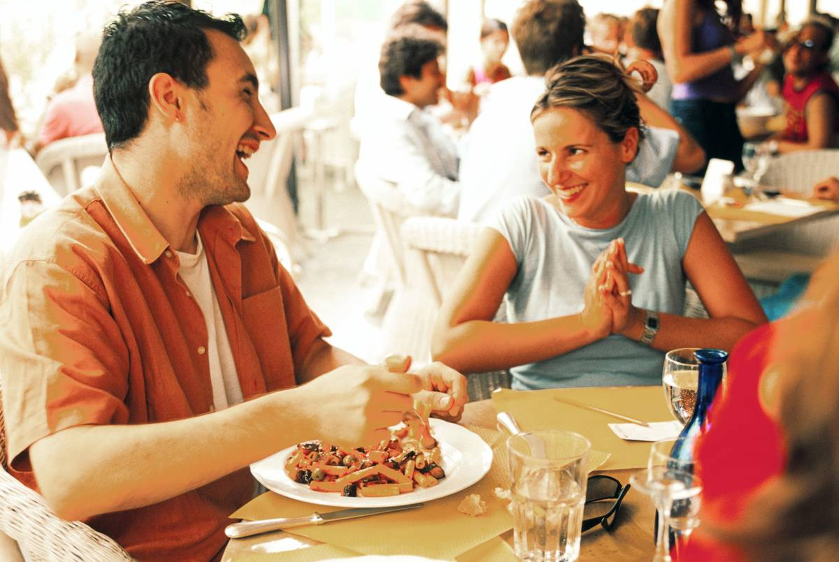 A couple eats at a restaurant in Milan, Italy.