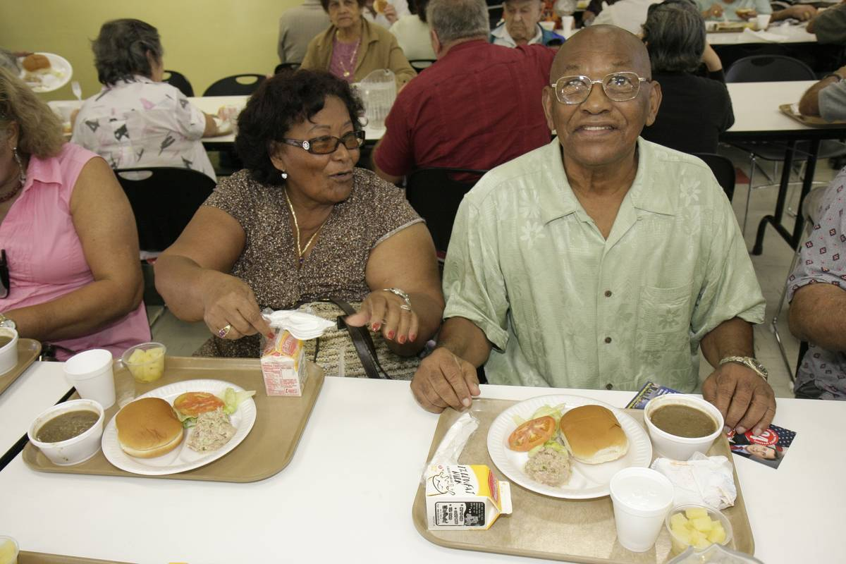 A couple eats lunch together at a community center.