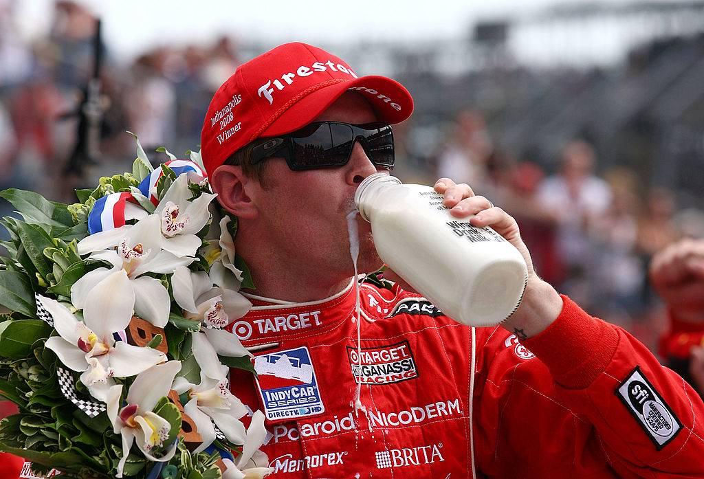 Scott Dixon drinking a bottle of milk