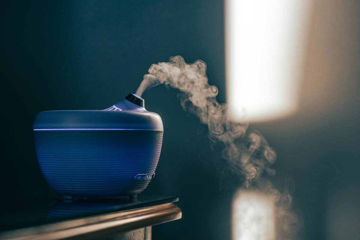 An essential oil diffuser scents the air.