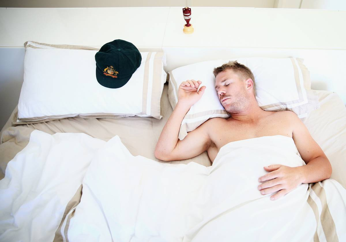 A man sleeps in bed.