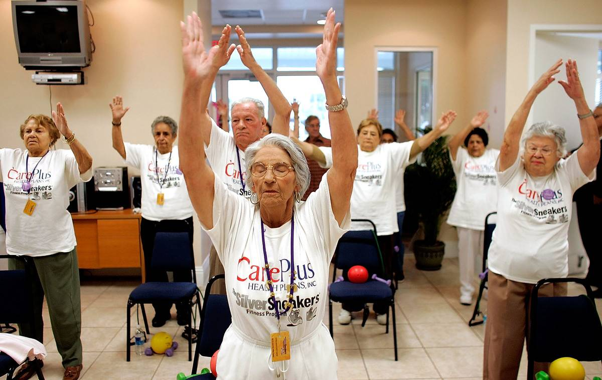 Seniors stretch during an exercise class.
