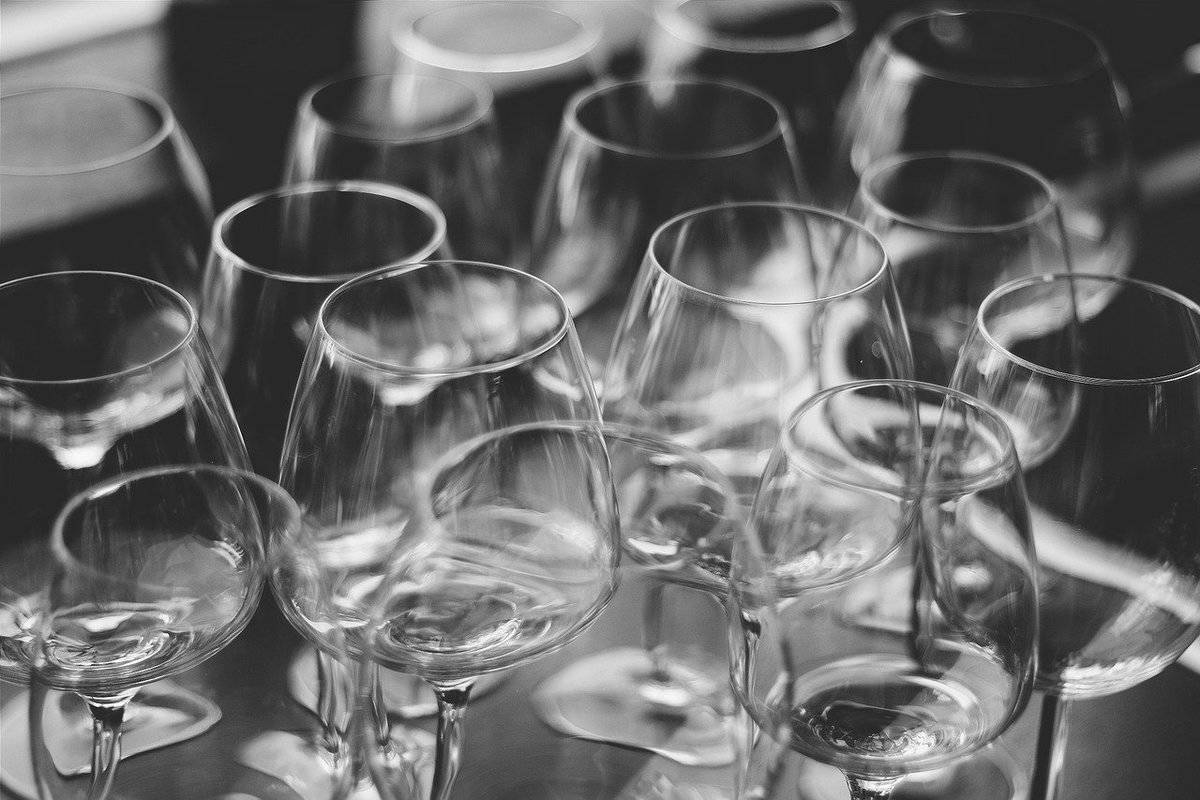 Empty wine glasses are arranged on a table.
