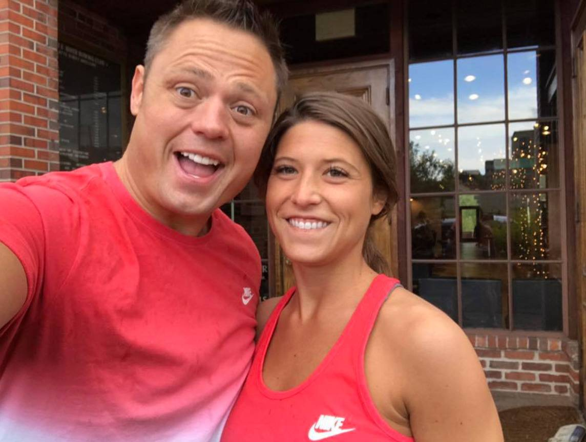 Bruce Pitcher poses for a photo with his wife after a marathon.