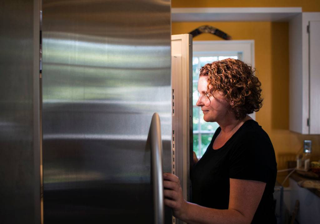 Picture of woman and refrigerator