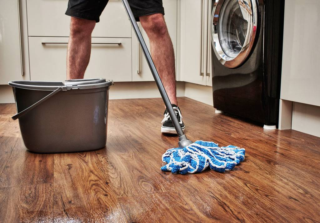 Picture of man mopping