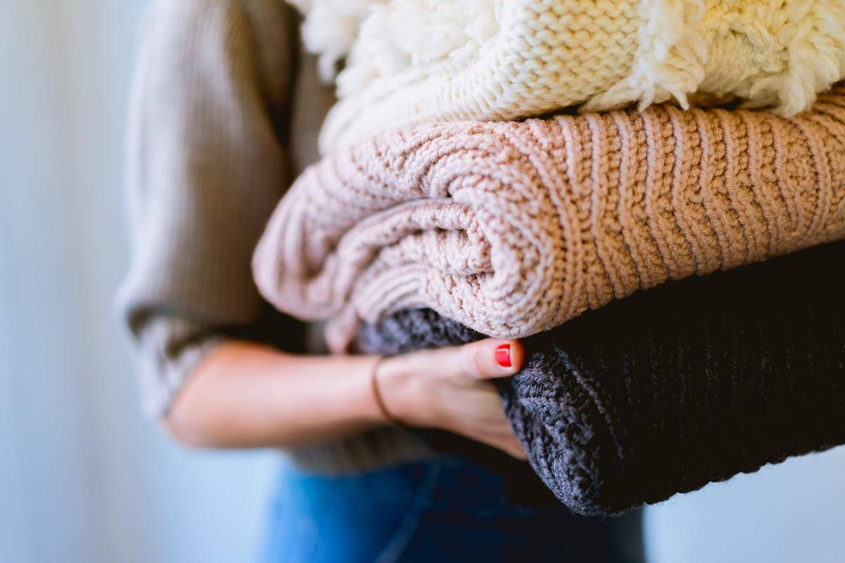Woman holding blankets