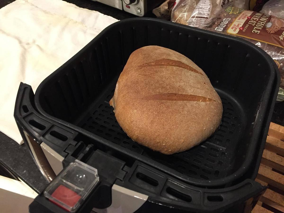 Baked bread is seen in an air fryer.