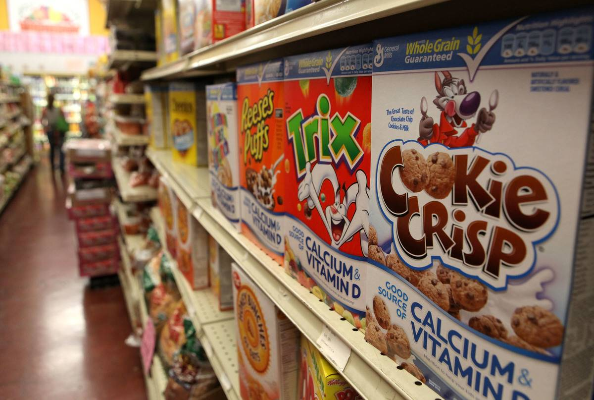 Boxes of sugary breakfast cereals line grocery store shelves.