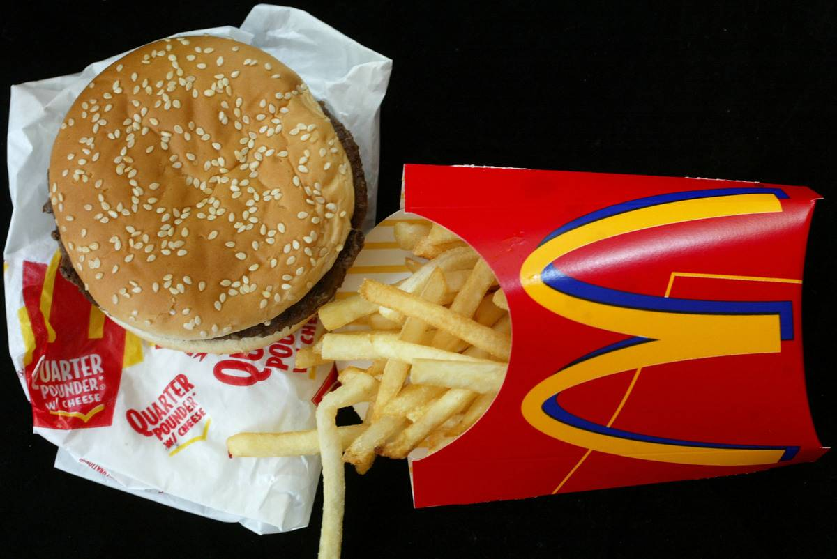 A burger and fries from McDonald's lie on the table.