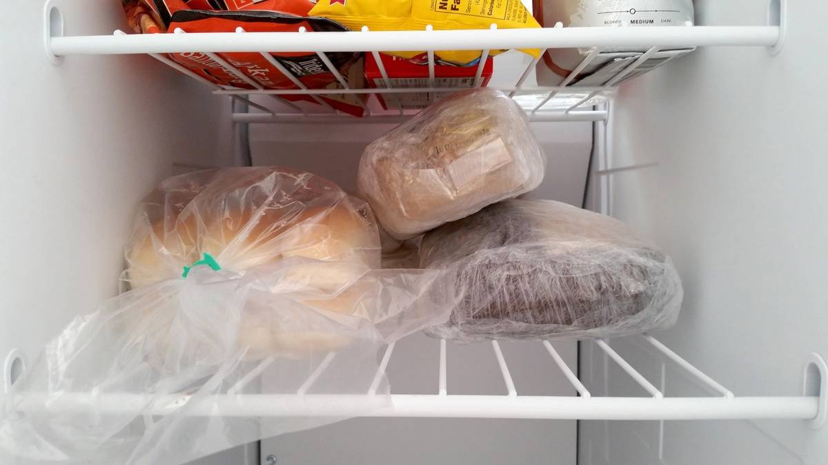 Bread loaves are stored in a freezer.