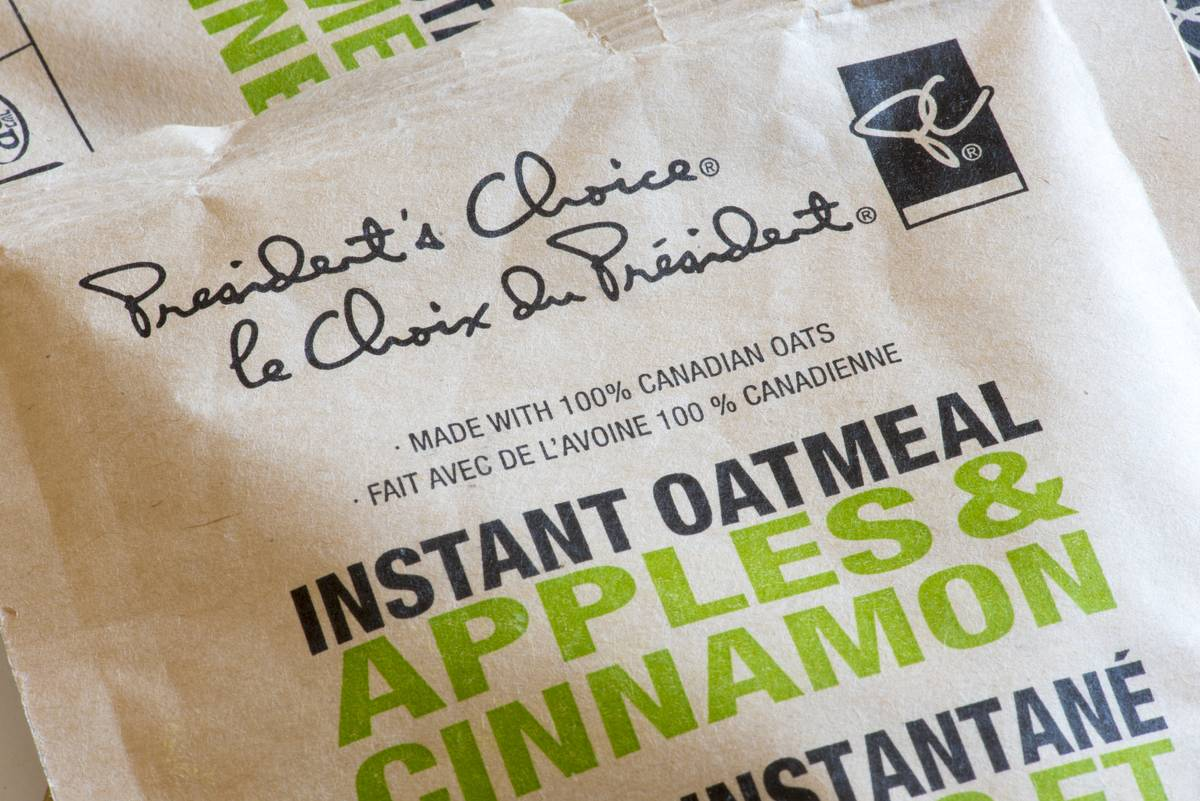 A photo looks closely at a packet of apple cinnamon flavored instant oatmeal.