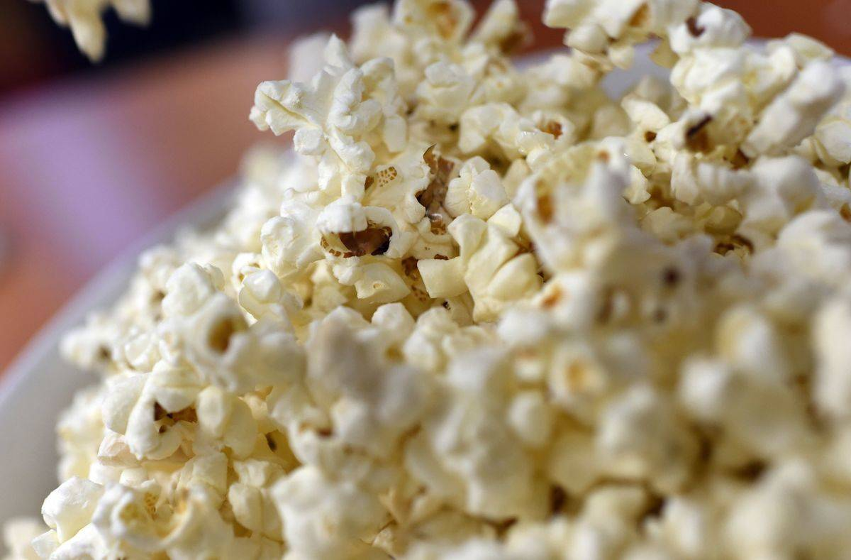 A close-up picture shows a pile of popcorn.