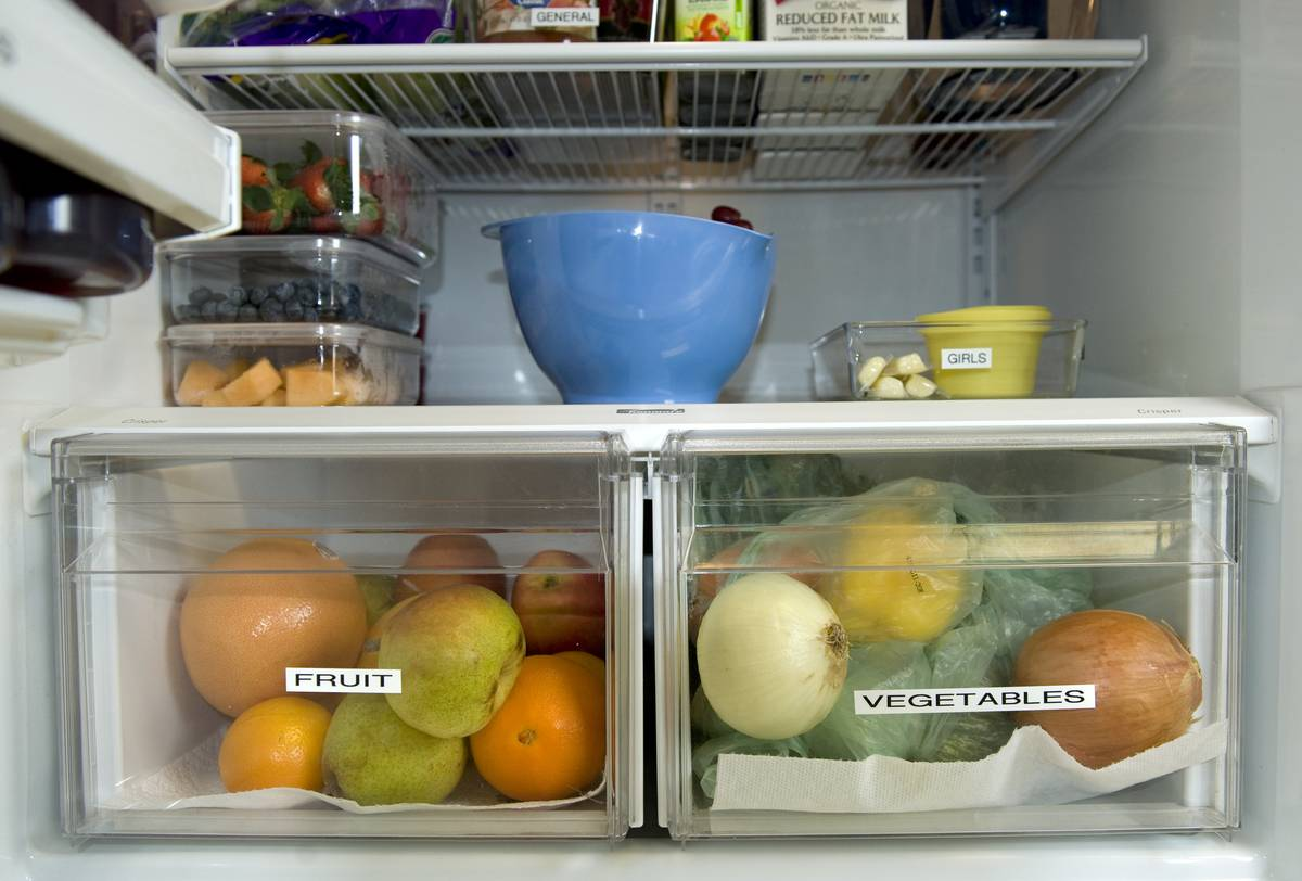The inside of a refrigerator is labeled and organized.