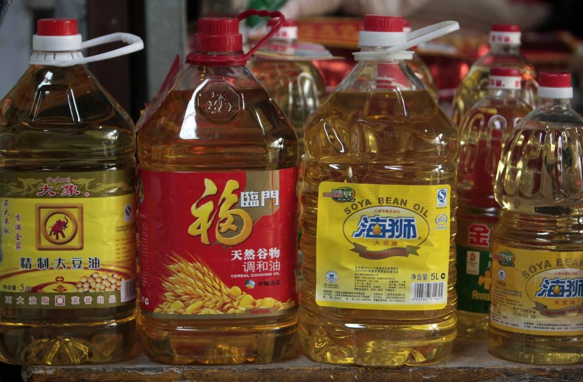 Bottles of soybean oil sit on shelves in a wholesale market.