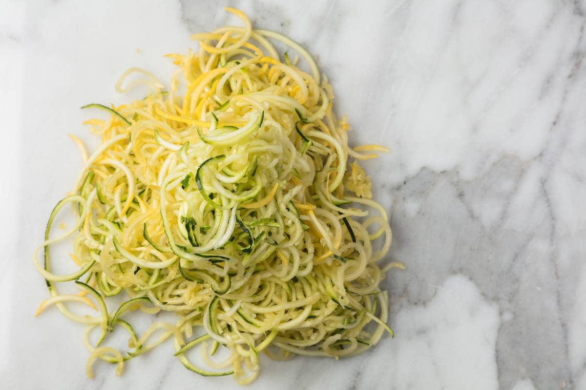 Zucchini noodles sit in a pile.