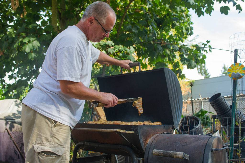Picture of man grilling