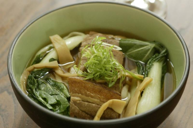 A bowl of udon noodles includes bamboo shoots.