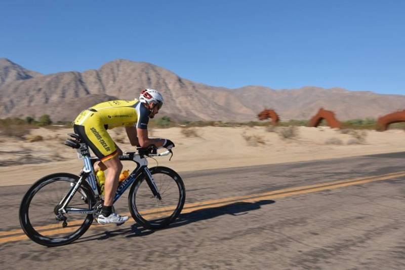 man riding his bicycle on a road in bicycle dreams