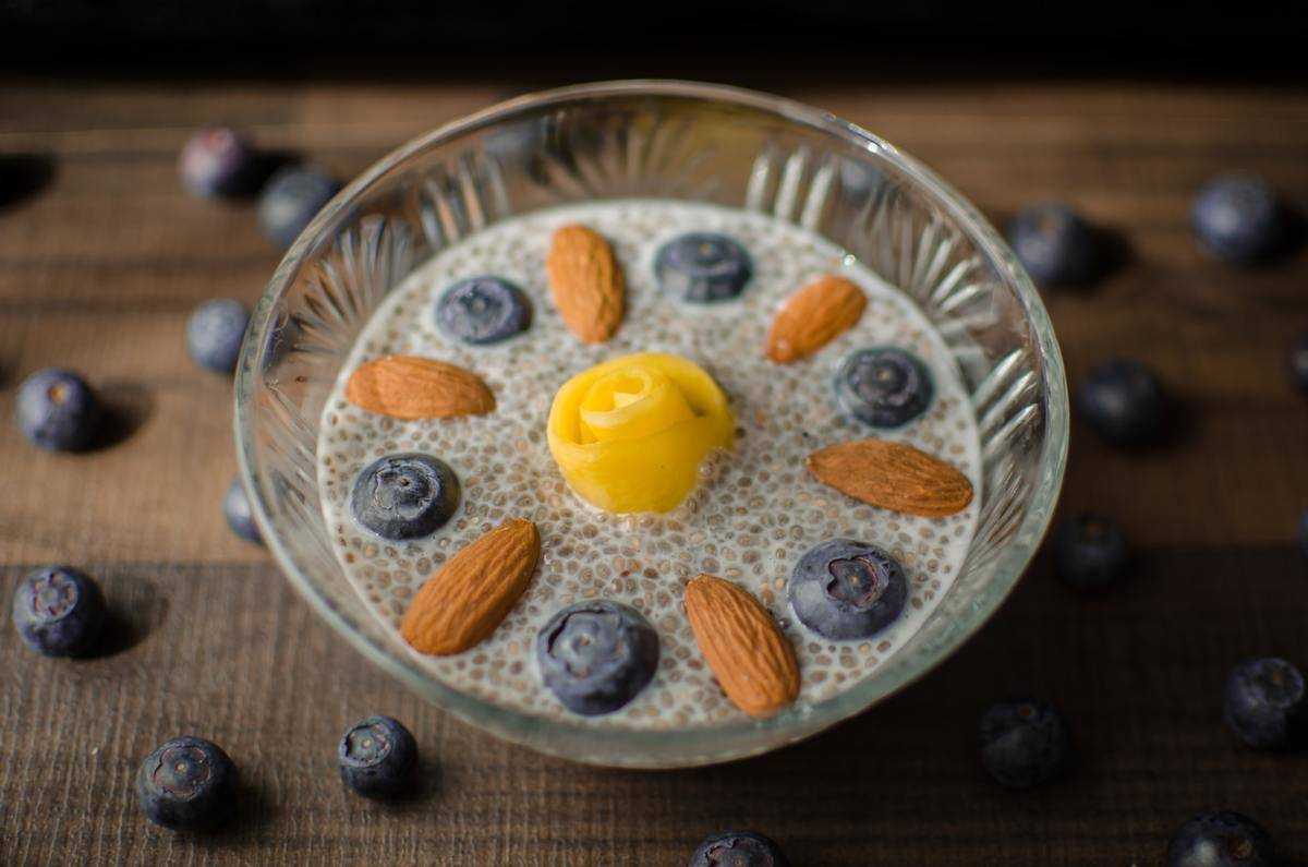 Chia seed pudding is topped with blueberries, almonds, and mango.