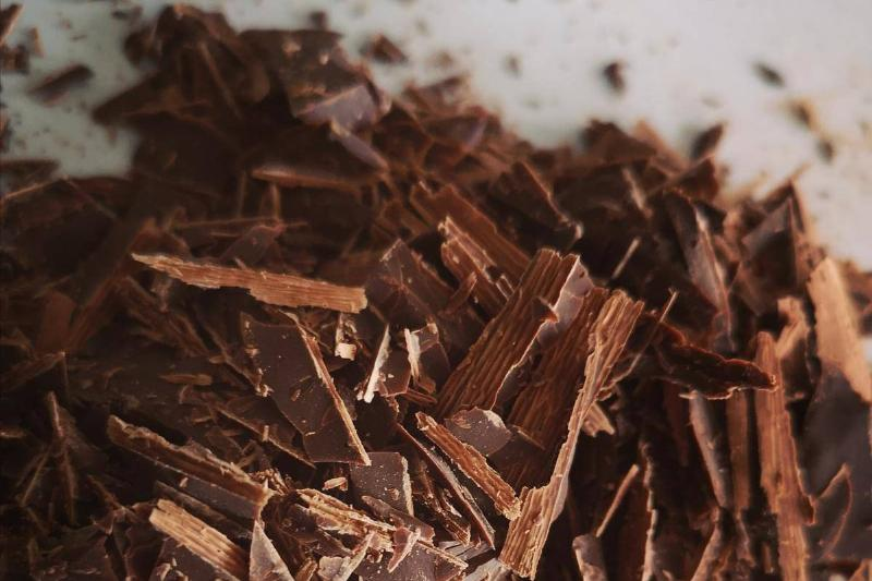 Dark chocolate shavings lie in a pile.