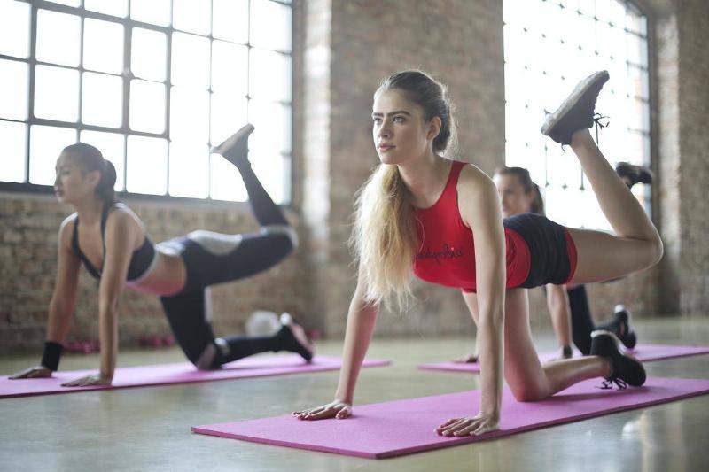 Woman do yoga during a yoga class.