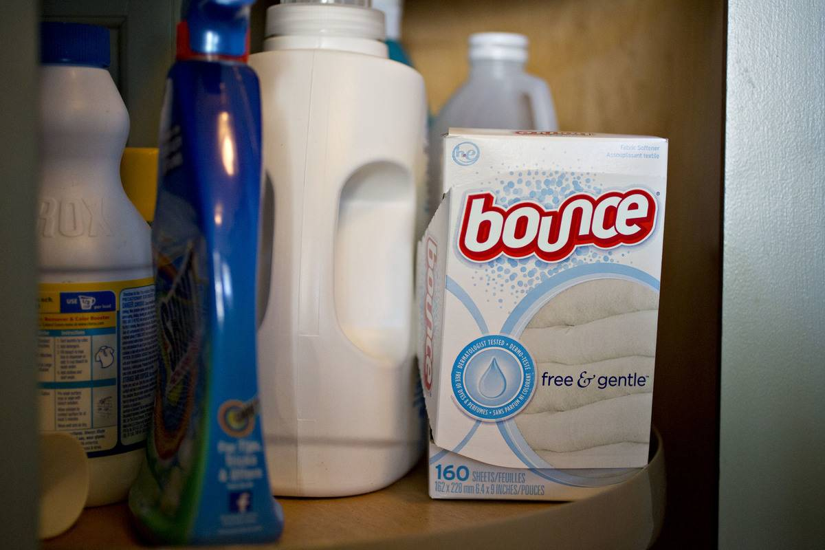 Bounce dryer sheets are stored next to other laundry supplies.