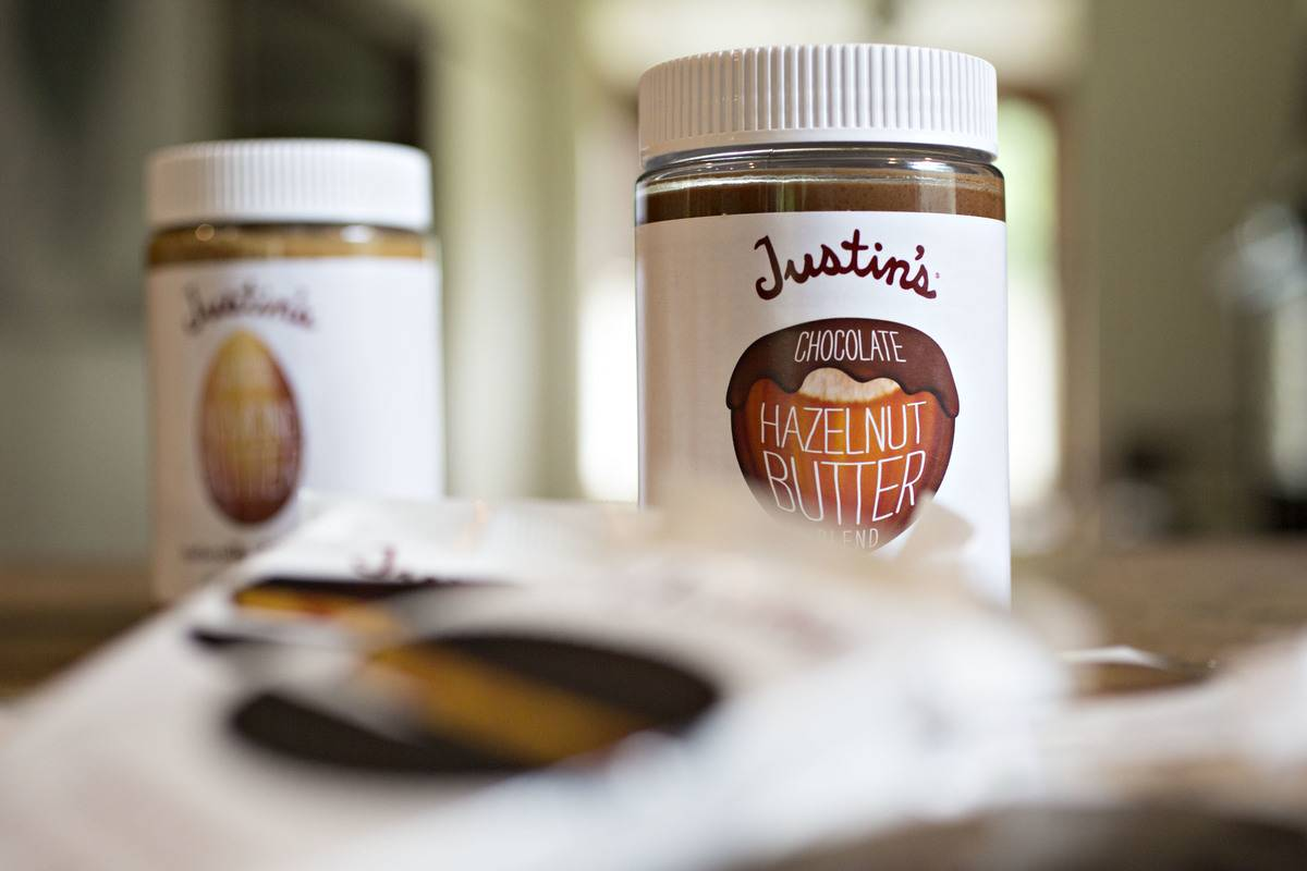 Containers hold hazelnut chocolate butter.