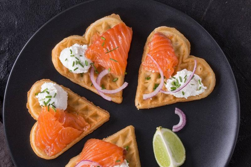 Salmon is on wafers shaped as hearts.