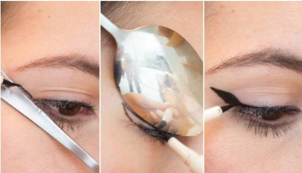 A woman uses a spoon to outline her winged eyeliner.