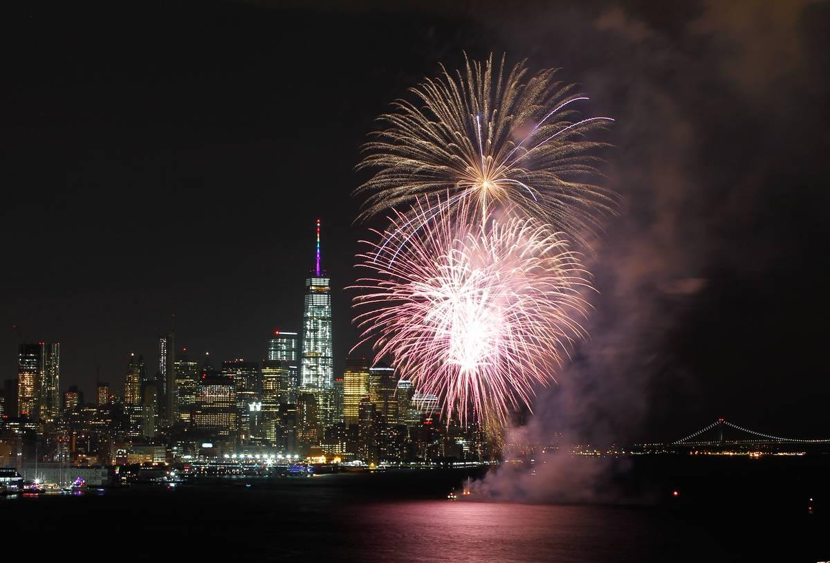 Firworks explode above the Hudson River in Lower Manhattan.