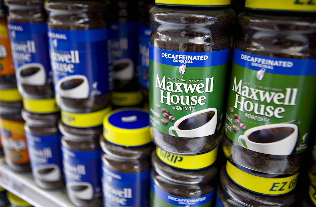 Containers of Maxwell House instant coffee is on display on supermarket shelves.