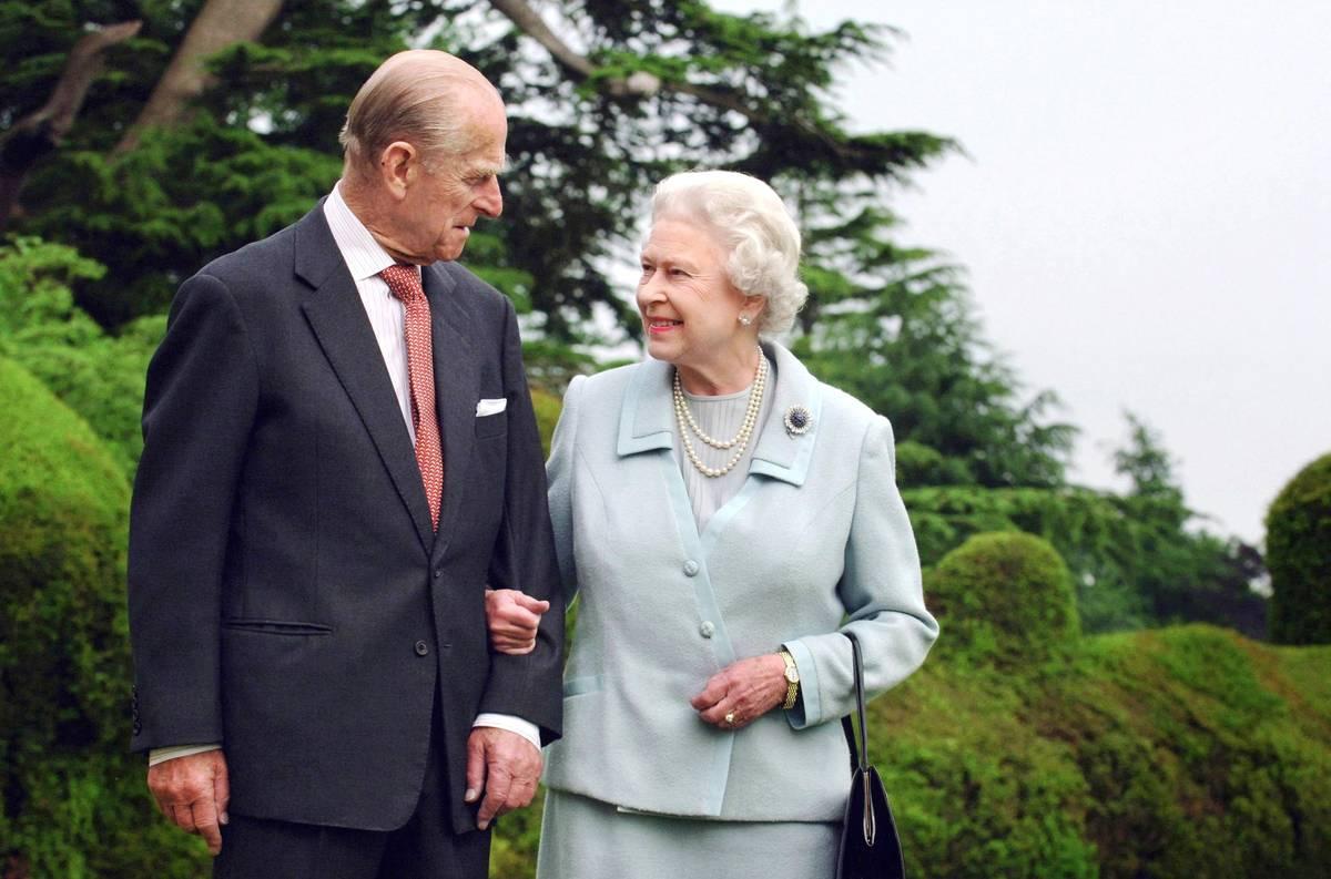 Prince Philip and Queen Elizabeth II speak to each other.