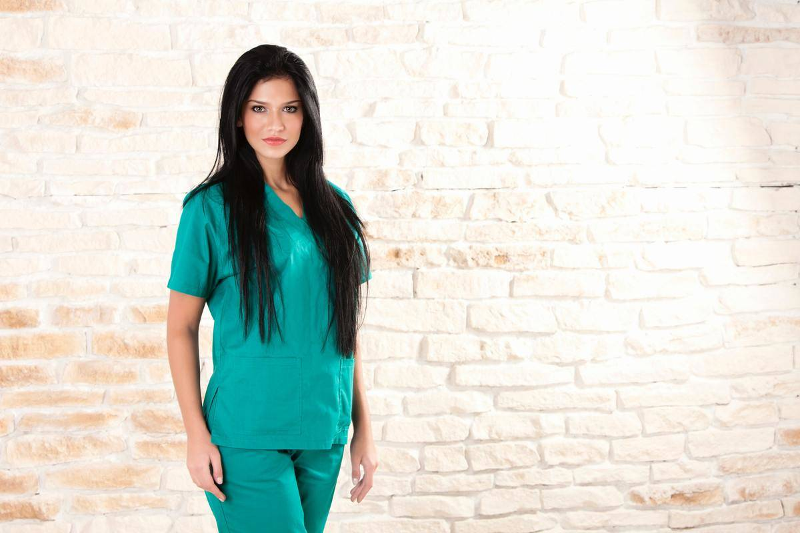 doctor in green scrubs