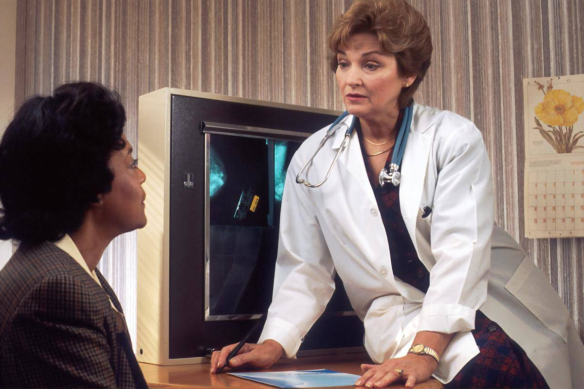 doctor talking to a patient in a retro office