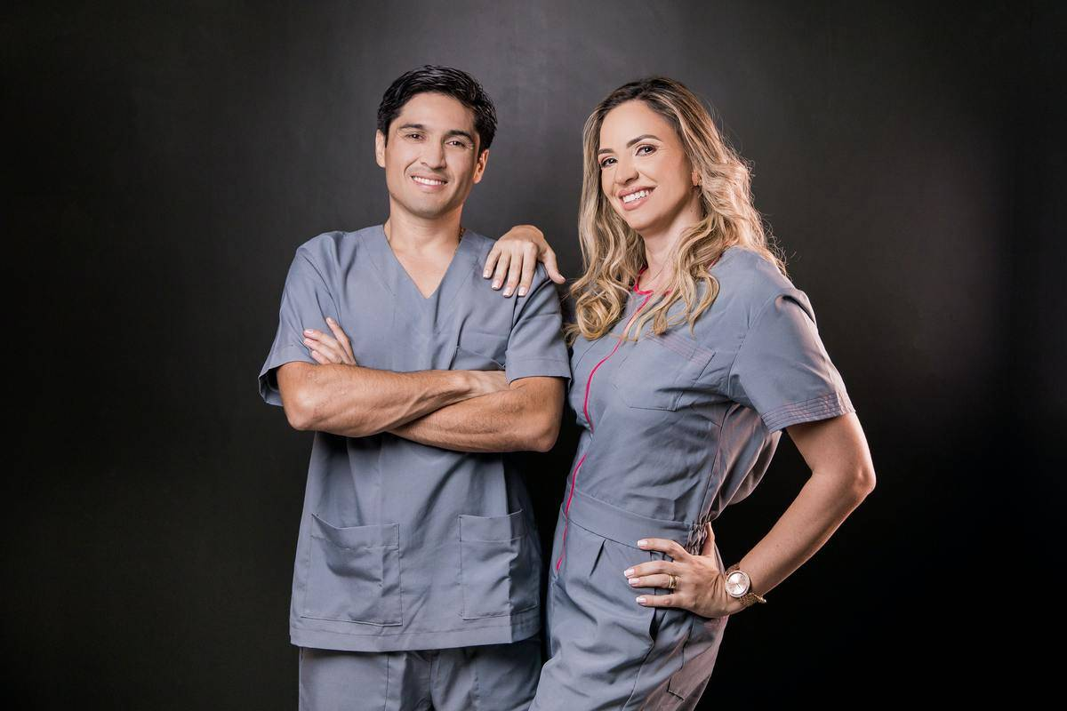 male and female doctors posing for a photo