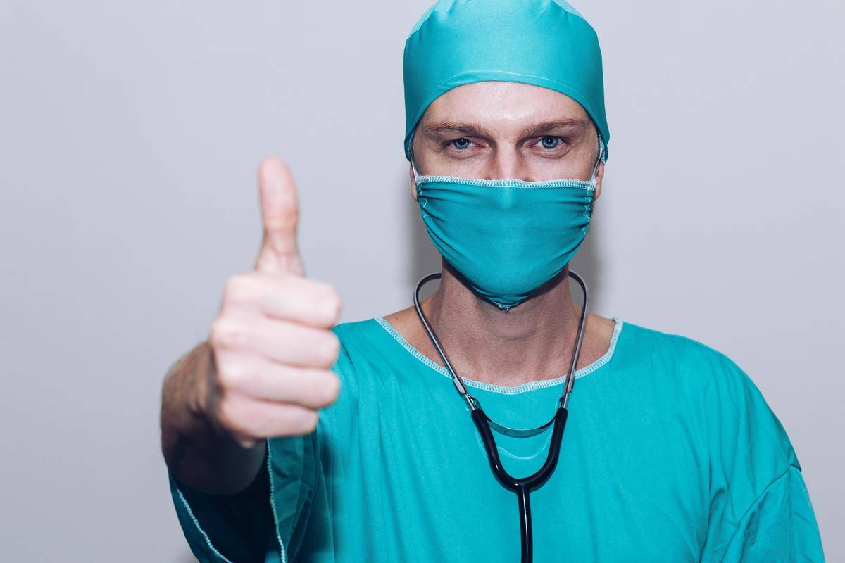 doctor holding a thumbs up