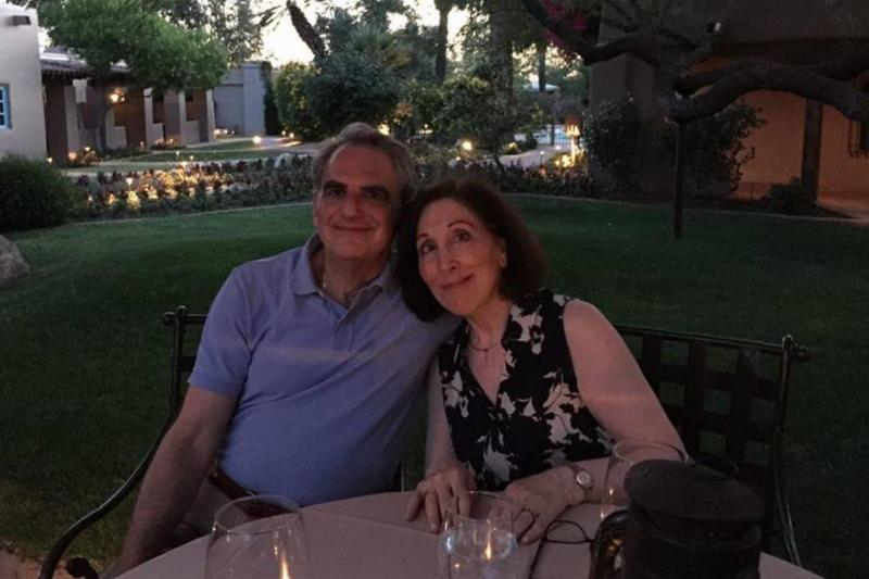 Marc and Liane take a photo together while on a dinner date.